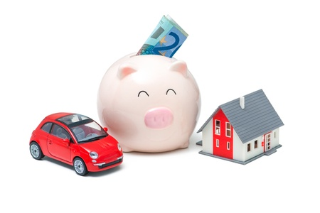 Piggy bank and house on the white background