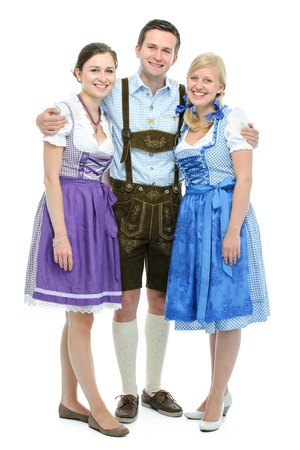 group of young people in traditional bavarian tracht isolated on white photo