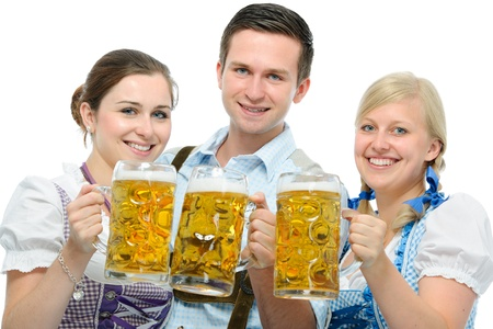 group of young people in traditional bavarian tracht holding Oktoberfest beer steins photo