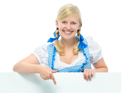 young woman in dirndl holds ad space and smile photo