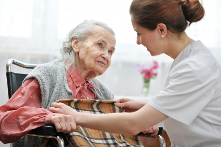 care at home: Female nurse is taking care of the senior woman