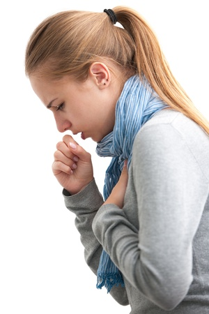 portrait of an young woman coughing with fist photo