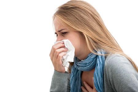 snort: Portrait of a young woman sneezing In to tissue