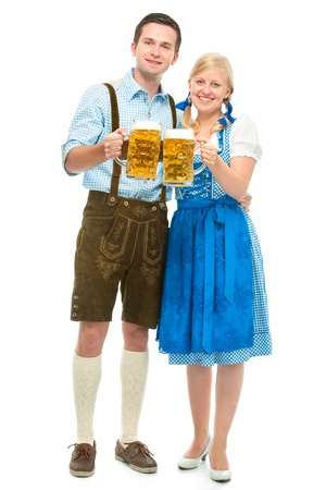 happy bavarian couple in dirndl with oktoberfest beer