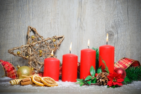 burning time: christmas decoration background with four advent candles burning