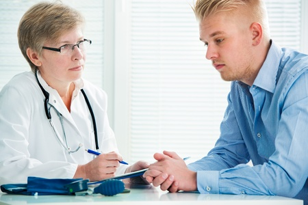 depletion: Young man visits doctors office suffering with depression Stock Photo