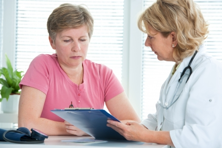 physician discusses test results with her female patient Stock Photo