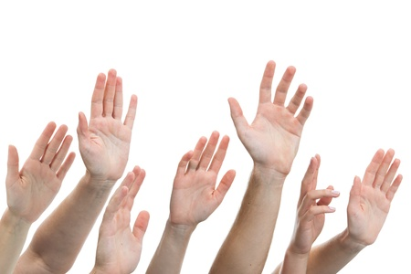 hand lifted: Close-up of several human hands raised on white background Stock Photo