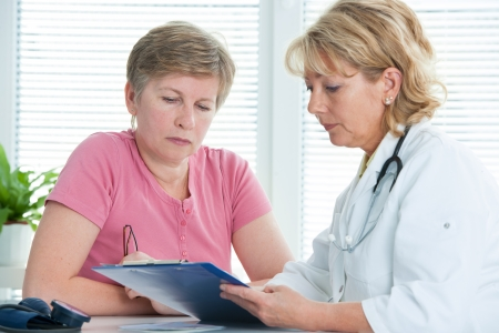 exam results: physician discusses test results with her female patient Stock Photo