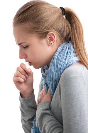 attacks: portrait of an young woman coughing with fist
