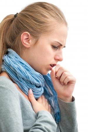 portret van een jonge vrouw hoesten met vuist Stockfoto