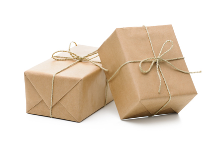 wrapped present: Group of parcels wrapped with brown paper and tied with string. Isolated on white background Stock Photo