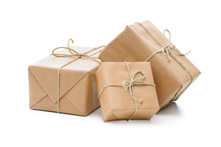 Group of parcels wrapped with brown paper and tied with string. Isolated on white background photo