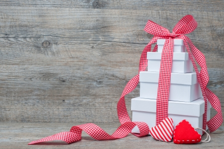Stack of gift boxes with ribbon and bow  on old wooden background Reklamní fotografie