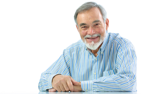 older men: Portrait of  senior man sitting isolated on white background