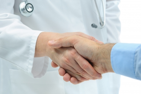 welcome people: Doctor shakes hands with a patient isolated on white  background Stock Photo