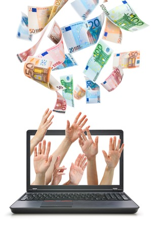win money: Hands comes from laptop screen reaching for Euro money flying in the air Stock Photo