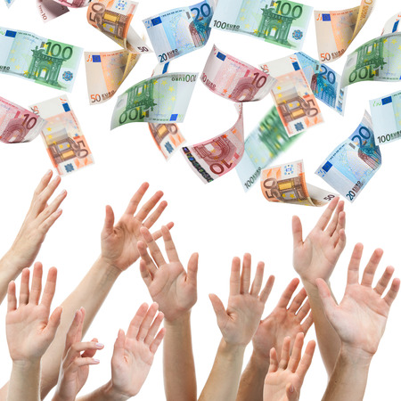 euro banknote: Hands reaching for Euro money flying in the air