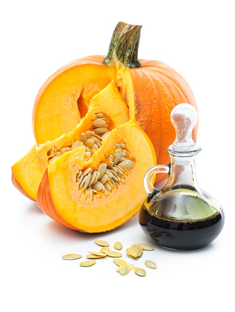 Fresh pumpkin oil  isolated on white background photo