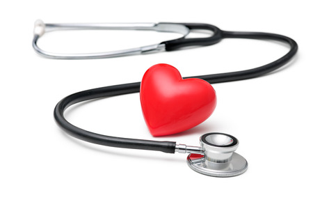 A  heart with a stethoscope  isolated on white background photo