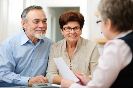 financial planning married: Senior couple discussing financial plan with consultant