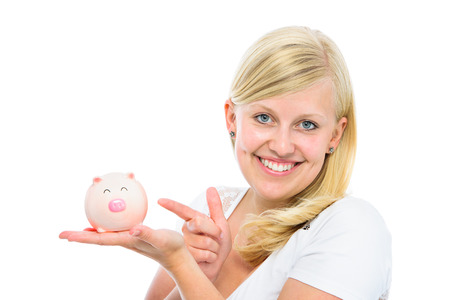 Portrait of smiling young woman holding piggy bank photo
