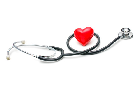 auscultation: A  heart with a stethoscope  isolated on white background