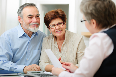 financial strategy: Senior couple discussing financial plan with consultant