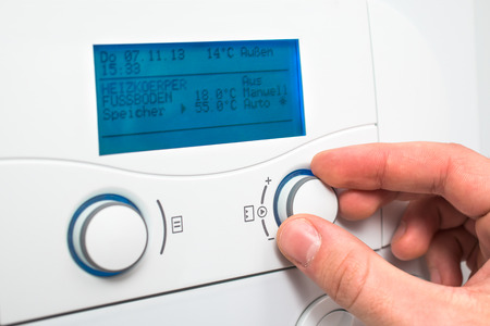 economizing: Control panel of the gas boiler  for hot water and heating Stock Photo