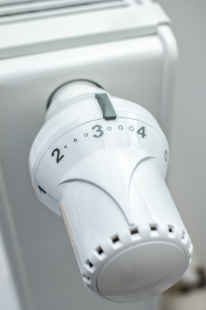 economizing: Close up of thermostat on a heating radiator