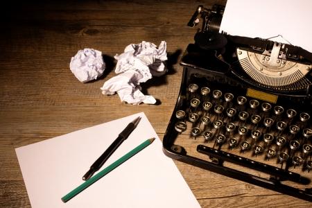 secretarial: Vintage typewriter and a blank sheet of paper