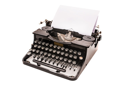 Vintage typewriter with paper sheet isolated on white photo