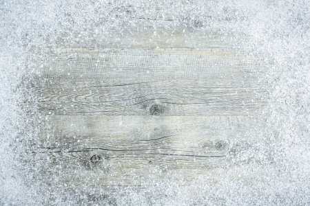 Old wooden board with snow flakes . Christmas background photo