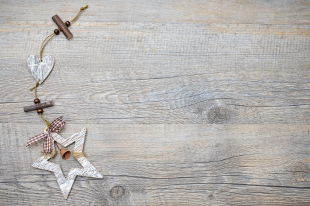 Christmas decoration over a vintage wooden background