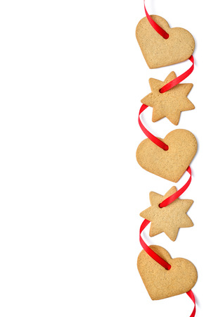 gingerbread cookies: Christmas cookies with red ribbon isolated on white