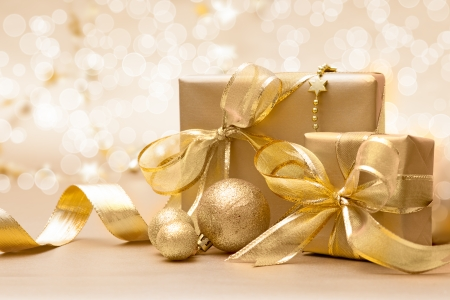 xmas card: Gold Christmas gift boxes with bow and ribbon Stock Photo