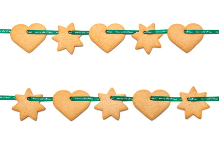 christmas cookies tied with green ribbon isolated on white photo