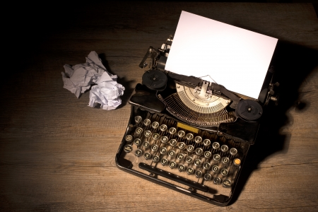 Vintage typewriter and a blank sheet of paper photo