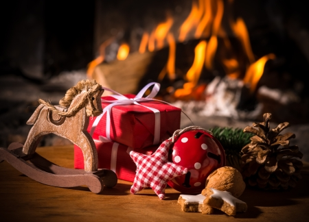 Christmas scene with tree gifts and fire in background Imagens - 24202335