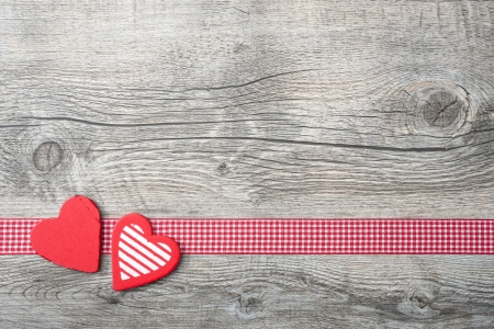 Valentines Day background with patterned hearts on old wooden Imagens