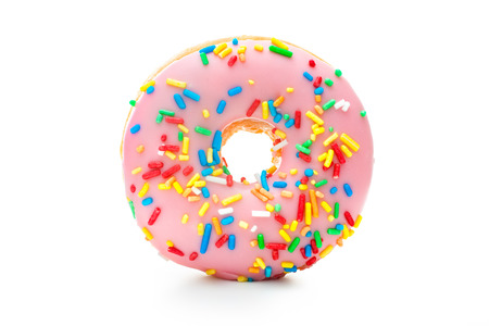 Donut with sprinkles isolated on white background photo