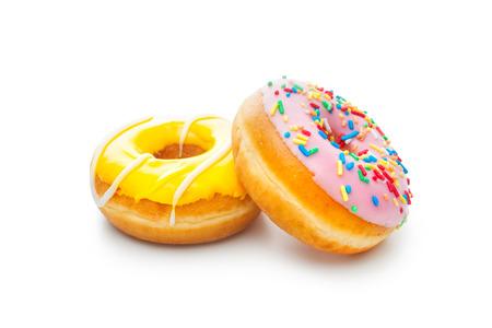 白で隔離される 2 つの艶をかけられたドーナツ 写真素材