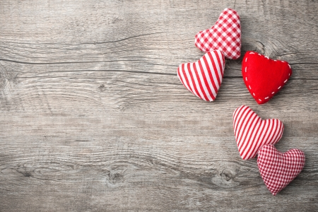 mothers: Valentines Day with patterned textile hearts on old wooden