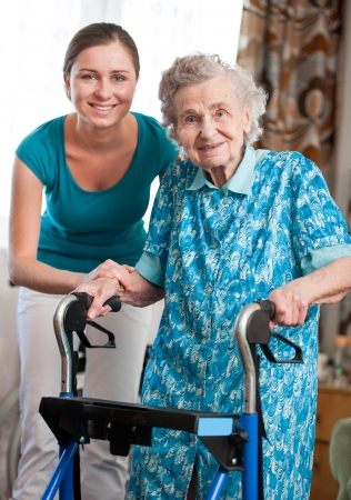 home care nurse: Senior woman with her caregiver at home Stock Photo