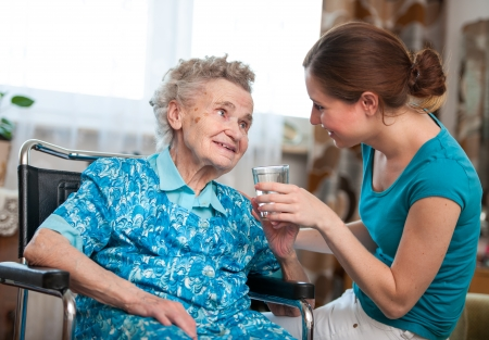 nursing: Senior woman with her caregiver at home Stock Photo