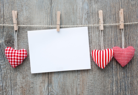 valentin day: Message and red hearts on the clothesline against wooden background