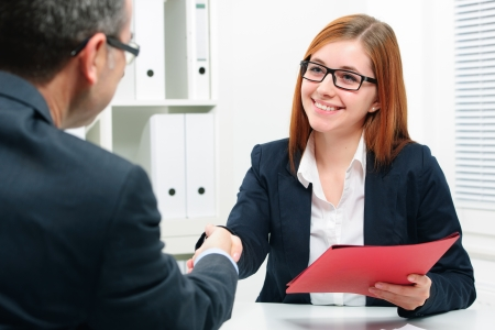 negotiate: Man and woman Handshake to seal a deal after a job recruitment meeting