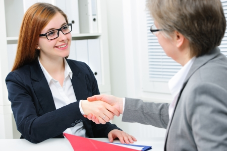 handshaking: Women Handshake to seal a deal after a job recruitment meeting