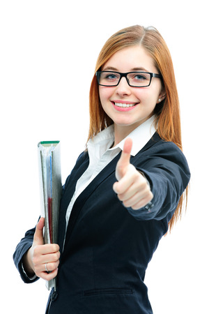 Businesswoman with a folder smiling and showing thumbs up against white background photo