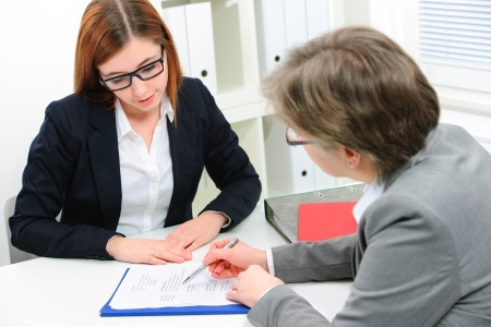 JOB INTERVIEW: Young woman discussing during a job interview at office